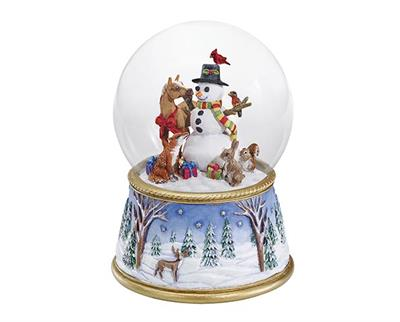 "The snow globe's base is adorned with a serene nighttime woodland scene, complete with a stag surveying his domain. This Musical Snow Globe plays ""Deck the Halls."""