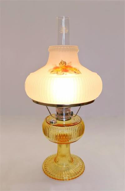Model #100023034 features hand-painted Chrysanthemum floral design in autumn shades of orange, amber, honey, rust, tans, browns, and greens on a frosted glass Grand Vertique shade. The lamp is accented with Nickel plated brass hardware and comes with a Ma
