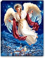 An elegant angel soars above a winter mountain side town scene. Brilliant sapphire blue night sky with stars above. Town features snow capped buildings, and a church with steeple.