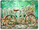 Shabby chic bicycle with white picket fence