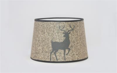"Bring a touch of rustic charm to any lamp. This new shade from Aladdin features a majestic buck deer silhouette on a warm burlap textured background. 12"" base diameter, this style of Parchment (Paper) shade does not have a built-in tripod. 12"" tripod/shad"