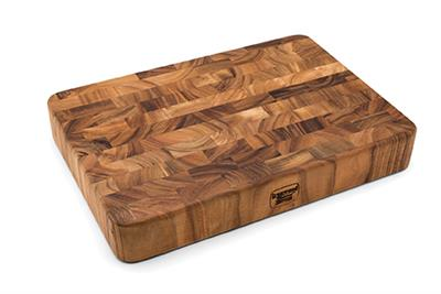 Made of gorgeous Acacia hardwood, this Rectangular End Grain Cutting Board is functional and beautiful due to its rich, shimmering colors. Unlike traditionally made boards, end grain construction is less dulling to cutlery because the wood grain direction
