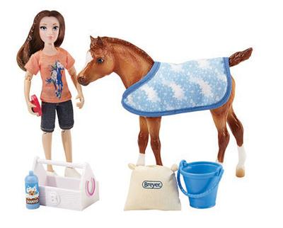 "This engaging set from Breyer Model Horses comes with everything needed to give the pony a bath and some pampering! Includes: 6"" articulated doll, pony, pony blanket, bucket, tack box, feed bag, curry comb, and shampoo bottle."
