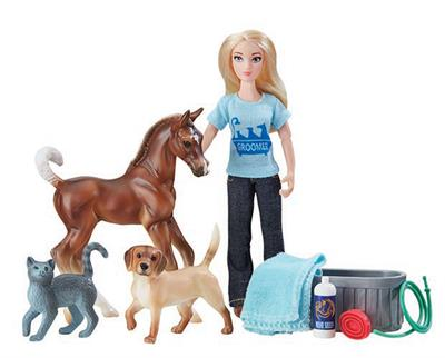 "This engaging set from Breyer Model Horses includes everything needed to help the groomer get the animals clean and looking great. Includes: 6"" articulated doll, pony, cat, dog, water trough, towel, shampoo bottle, and curry comb. Classics Size Models."