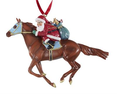Santa trades in his reindeer in favor of a new form of transportation in this fun ornament! Santa is in the irons of a beautiful chestnut Thoroughbred racehorse, and he's speeding down the home stretch of Christmas Eve! With his bag of gifts slung over hi