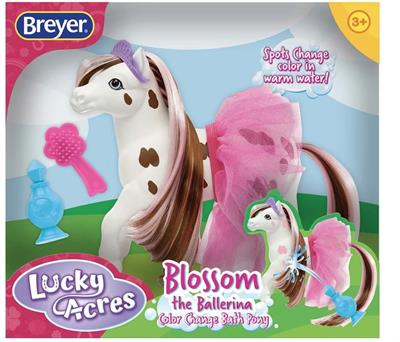 "Breyer Horses Blossom the Ballerina Color Changing Appaloosa #7213 Includes: ""perfume"" squirt bottle, hairbrush, tutu and tiara.  When this friendly Appaloosa is done pirouetting and prancing, she hops in the bath. Surprise! Her brown markings turn pink i"