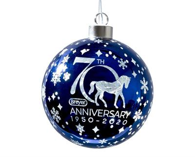 This special light-up ornament was created to commemorate Breyer's 70th anniversary! A stunning blue glass ball is covered in etched snowflakes and features the Breyer 70th anniversary logo. An on/off switch on the battery case activates the LED lights in