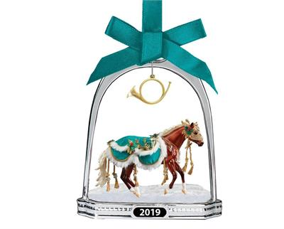 Breyer's classic Holiday Horse Stirrup Ornament features a finely-detailed miniature of Minstrel, the 2019 Holiday Horse. A lovely snowflake hangs from the top of the silver-toned stirrup, which frames Minstrel. Gorgeous and glittering, this ornament hang