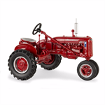 This 1:16 replica of a Farmall B tractor features a Blue Ribbon Service logo for the first time. The tractor has die cast body, seat, hitch frame, and narrow front axle. The rear hitch is compatible with most ERTL implements and the steering wheel turns t