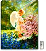 A young femal angel stands in the sunlight while standing in the forest with flowers
