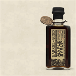 Woodinville Whiskey Company created a delicious barrel aged maple syrup from their empty bourbon and rye whiskey barrels. Pure, Grade A, Dark Amber Maple Syrup that was harvested from eastern United States is put away to age gracefully in the whiskey barr