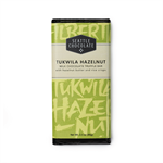 Hazelnut butter and brown rice crisps in milk chocolate. This new bar has a special meaning for Seattle Chocolate Company. Tukwila is the Duwamish People's word for hazelnut, and the area of Seattle where our factory is located. The bar has a rich Europea